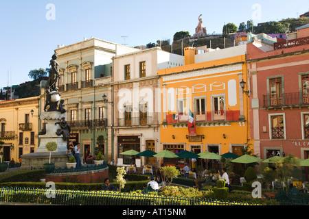 MEXICO Guanajuato Statue and restaurants in Plaza de la Paz El Pipila statue on hill above city Peace Plaza - Stock Photo