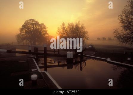 Papercourt Lock River Wey Navigation on a misty autumnal dawn Surrey England UK - Stock Photo