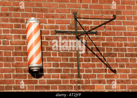 traditional barbers pole advertising hairdressers hair cutting services outside of an authentic old fashioned barbers - Stock Photo
