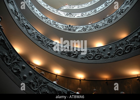 The double spiral stairway designed by Giuseppe Morno in 1932 as entrance to the Vatican Museums is now the museums' - Stock Photo