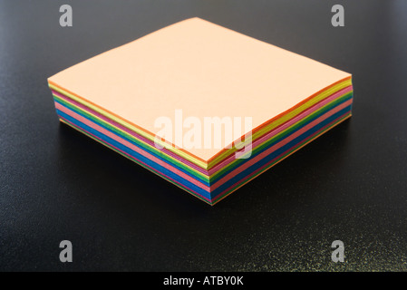 Stack of multicolored paper, close-up - Stock Photo