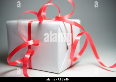 Gift wrapped in ribbon, close-up - Stock Photo