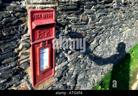 Postbox built into an old slate wall in the seaside fishing village of Port Gaverne near Port Isaac North Cornwall - Stock Photo