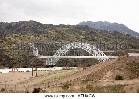 Pipeline bridge over Colorado River Topock Arizona AZ United States of America US U S A USA - Stock Photo