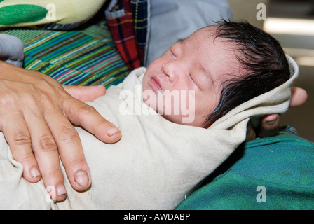 Newly born baby in its mother´s lap, Mae Tao Clinic for Burmese refugees, Maesot, Thailand - Stock Photo