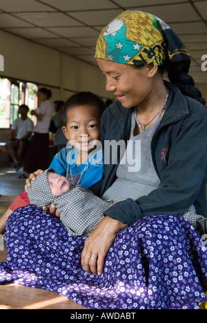 Mother with newly born baby and son, Kou Kou Clinic, Swe Kou Kou village, IDP-Area bordering Thailand near Maesot, - Stock Photo