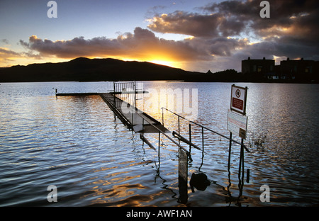 Sunset over Lake Trawsfynydd and the redundant Trawsfynydd Nuclear Power Station, Wales - Stock Photo
