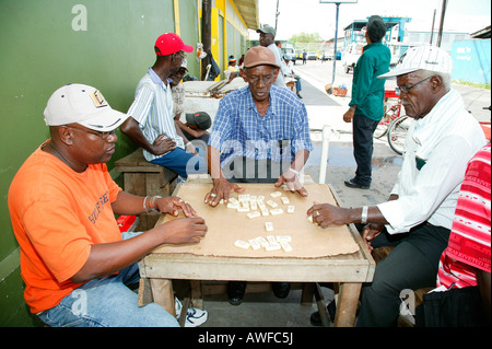 Men playing dominos at the market square in Georgetown, Guyana, South America - Stock Photo