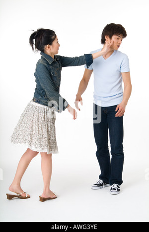 Young woman slapping her boyfriend - Stock Photo