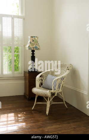 Armchair and lamp in bedroom corner in London home of a well known chef - Stock Photo