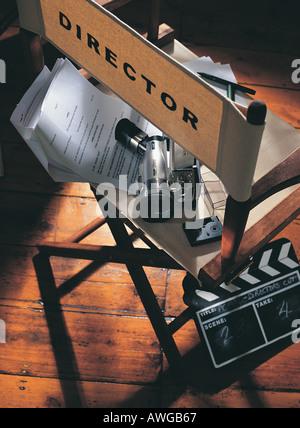A directors chair script and clapper board - Stock Photo