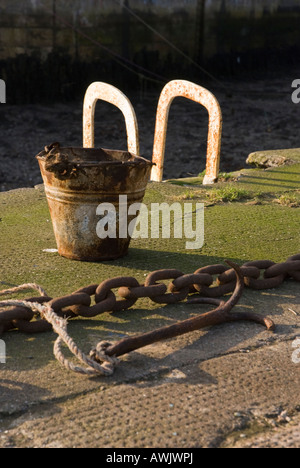 Bucket, Anchor and Chain on Burnmouth harbour wall, Scotland - Stock Photo