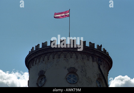 Latvian flag on the tower of the Cesis Castle, Latvia - Stock Photo