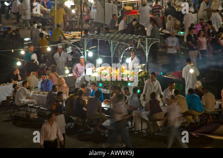 Horizontal aerial close up of the open air food stalls cooking fresh produce in the market square Place Jemaa el - Stock Photo