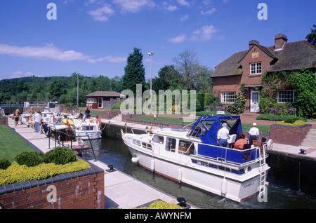 Hambleden Lock gates River Thames valley house cruising cruise cruisers boats people holidays afloat Berkshire England - Stock Photo