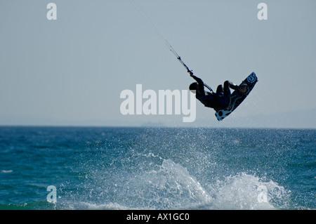 Spain Andalusia Tarifa Speeding Kite Surfer Playa De Los Lances - Stock Photo