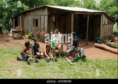 Women with children making a break in front of the house, Asuncion, Paraguay, South America - Stock Photo