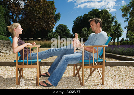 Man massaging his girlfriend's feet - Stock Photo
