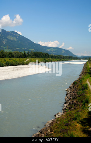 In the valley of the Rhine River border between lefthand Switzerland righthand Principality of Liechtenstein - Stock Photo