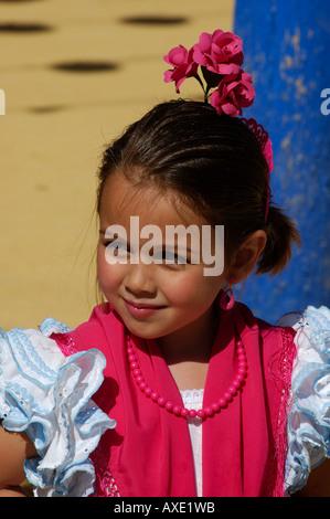 Portrait of a girl in Traje de Gitana , Feria de Abril , Sevilla , Andalusia , Europe - Stock Photo
