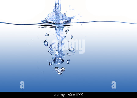 Running water viewed from above and below surface level - Stock Photo
