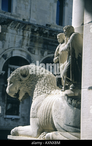 Cathedral church Statue Lion Two people Religious image - Stock Photo