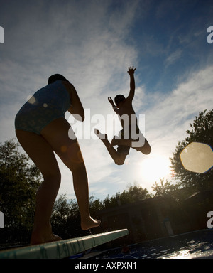 Launching into the air from a diving board - Stock Photo