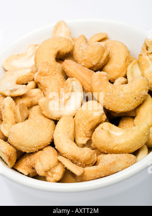 Cashew nuts in a white bowl close up - Stock Photo