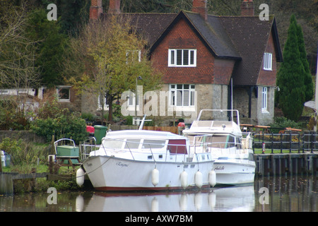 leisure boats moored front of lock keepers house river medway allington kent - Stock Photo