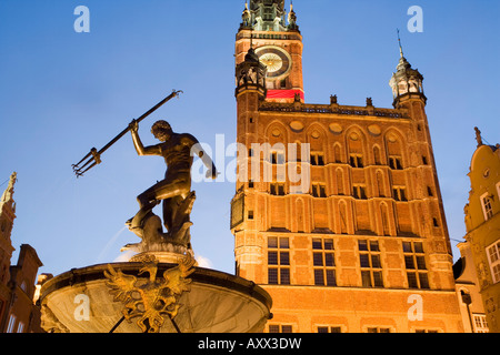 The Neptune Fountain and Town Hall illuminated at dusk, Dlugi Targ (Long Market), Gdansk, Pomerania, Poland, Europe - Stock Photo