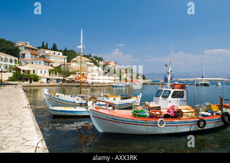 Fishing boats in the harbour in Kassiopi on the northeast coast of Corfu, Ionian Islands, Greek Islands, Greece, - Stock Photo