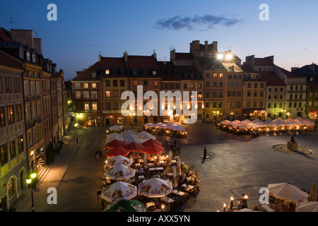 Elevated view over the square and outdoor restaurants and cafes at dusk, Old Town Square (Rynek Stare Miasto), Warsaw, - Stock Photo