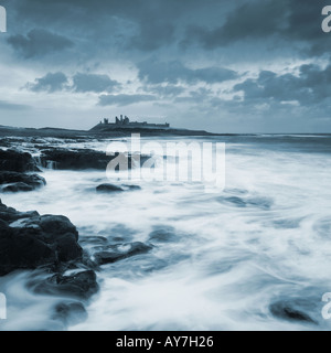 Dunstanburgh Castle from Embleton Beach Nothumberland England - Stock Photo
