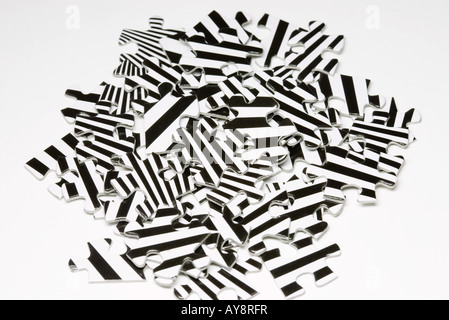 Jigsaw puzzle pieces in a heap, close-up - Stock Photo