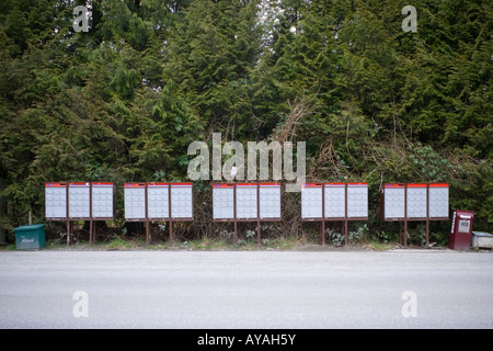 A row of Canada Post super mailboxes on a rural road Abbotsford BC Canada - Stock Photo