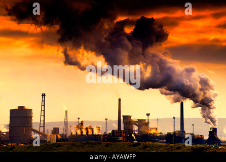 Smoking chimney showing pollution - Stock Photo