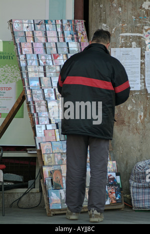 Pirate DVDs Software and Music CDs for Sale on a Street Corner in Eastern Europe - Stock Photo
