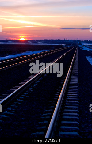 The sun sets over the rails of the Union Pacific mainline in Illinois. - Stock Photo