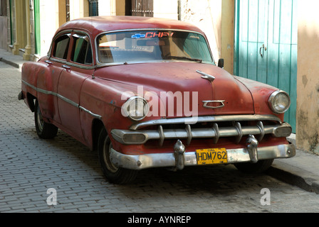 A Red, Classic American Car in the Old Town Area of Havana, Cuba - Stock Photo