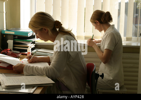 hospital staff working on medical records - Stock Photo