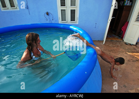 Netherlands Antilles Curacao an expat family in the swimmingpool - Stock Photo
