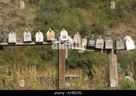 Row of mailboxes on the side of the road in Wyoming, USA - Stock Photo