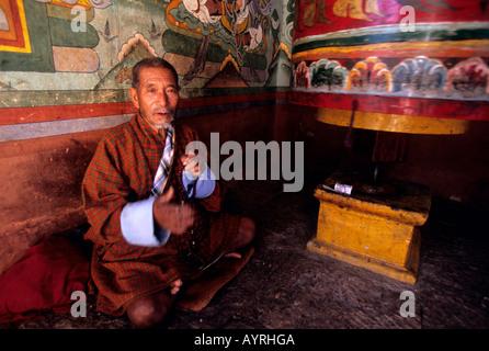 A faithful praying in the Punakha monastery. Bhutan - Stock Photo