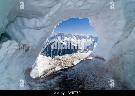 Ice grotto, entrance to Col du Midi (Midi Pass), Mt. Aiguille du Midi, Mont Blanc Massif, Chamonix, France - Stock Photo