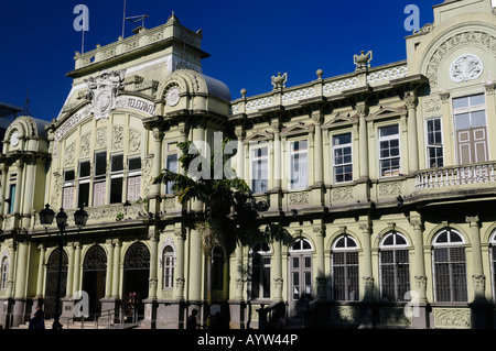 Corinthian Pilasters of Main post office building Correos Central in San Jose with morning sun and blue sky Costa - Stock Photo