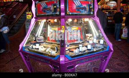 Penny falls machine in an amusement arcade, Scarborough - Stock Photo