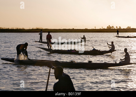 Mali, Niger Inland Delta. At dusk, Bozo fishermen fish with nets in the Niger River just north of Mopti. - Stock Photo