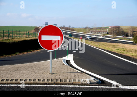 No entry sign on the slip road of a French motorway / autoroute - warning to drive on the right hand side of the - Stock Photo