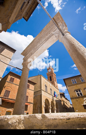 Palazzo Pubblico (Town Hall) seen from the columns of the well in Piazza Pio II, in the historic old town centre - Stock Photo