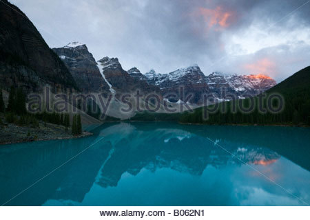 Several mountains in the Canadian Rockies tower over Moraine Lake located in Banff National Park. - Stock Photo